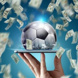online-sports-betting-dollars-are-falling-background-hand-with-smartphone-soccer-ball-creative-background-gambling_99433-5018
